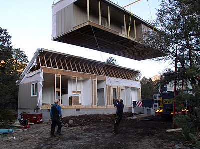 Photo of a work crew delivering a modular home